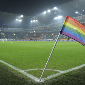 rainbow corner flag during a soccer match